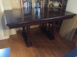 Hardwood table. Cherry stain seats 6-8 leaf included