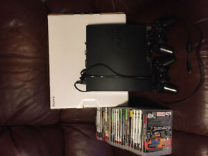 Price Drop - PS3 Game system with assortment of games.