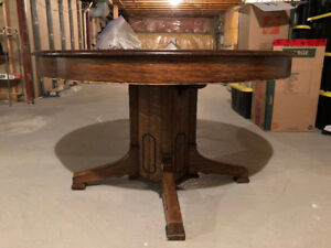 48 inch round oak harvest table with pedestal and 2 leafs