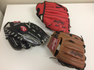 three children's Rawlings ball gloves in great shape