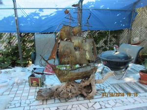 Art object/sculpture. Rusty shipwreck on driftwood from cape cod