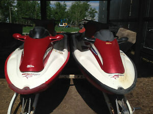 Two tiger shark jet skis and trailer
