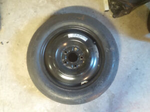 Spare donut tire excellent condition