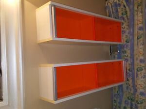 Funky orange and white wall cabinets