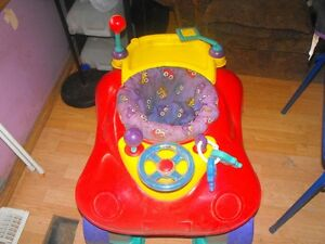 Exersaucer:trade for car or trike to push baby to school