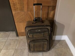 tracker leather rollaway luggage