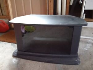 Swivel Tv stand with shelf, holds most tv's