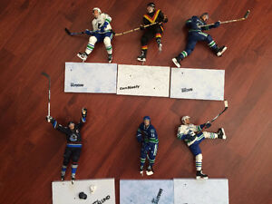A lot consisting of used Vancouver Canuck McFarlane figures