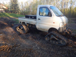 1999 Suzuki carry on tracks.  better and warmer than UTV or ATV