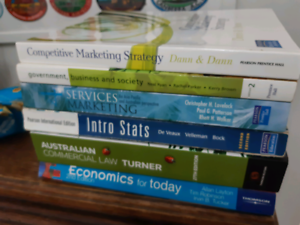 Economics for Today Commerial Law intro Stats Services Marketing
