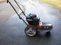 "WEED TRIMMER HUSQVARNA 24"" cut, Briggs Commercial 6 HP."