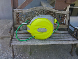 Self retracting hose reel with 50 ft hose.