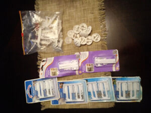 Child safety cabinet locks & outlet covers - unopened.