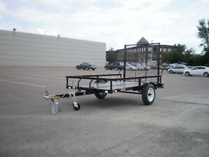 SnowBear ... Tilt utility trailer & Big tail gate ramp ...