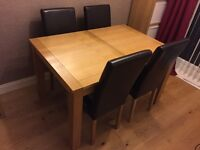Harvey's extending oak veneer dining table and 4 chairs