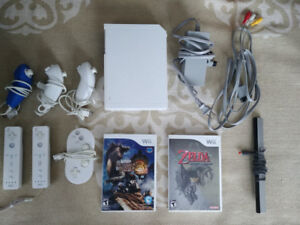 Wii w/ 2 wiimotes, 3 nunchuck, 1 classic controller and 2 games