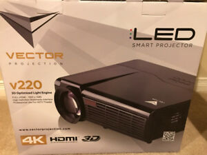 Vector 220 LED HD Projector with screen.  New in box