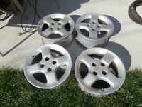 1 set 14' mags 4 bolts golf and other small cars mazda put on fo