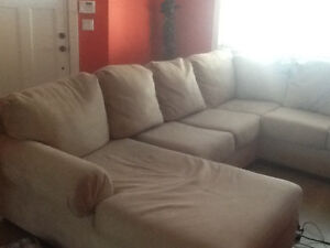 L shaped sofa, fireplace, kitchen aid, picture