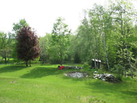 NEW LISTING - COUNTRY BUNGALOW WITH WALKOUT LOWER LEVEL