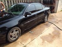 2002 grand am gt with sunroof and leather