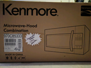 Brand new kenmore microwave _hood over the range$ 190