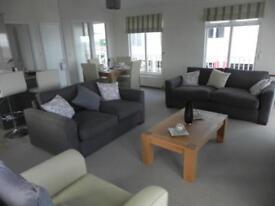 Luxury Ocean View Lodge With large Decking. 12 Month Season.Pet Friendy Site.