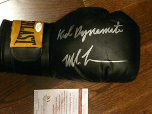 Mike Tyson signed boxing glove - various inscriptions JSA/COA