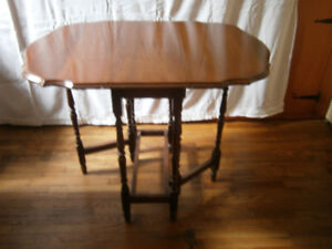 Lovingly cared for small wooden gate leg tea table.