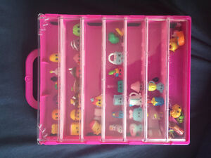 Lot of Shopkins with carrying case