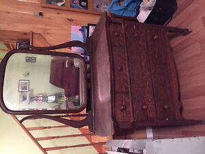Antique wooden wheeled dresser with mirror. Dove tailed drawers.