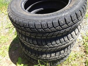 P155/80R13 studded tires set of four $200.00 Firm