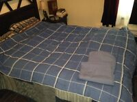 Two (2) Matching Comforters with blue sheet set