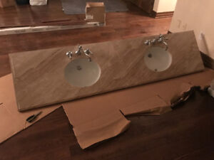 Marble vanity counter top with sinks and riobel faucets