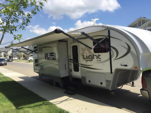 5th wheel, Slides out, sleeps 7, towed by a half ton truck