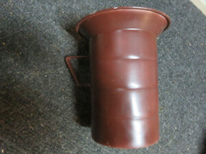 Old metal container with handle