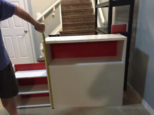 Ikea white headboard with red accents and pull out storage