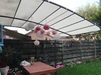 Gorgeous steel and canvas style house awning 3m x 3m