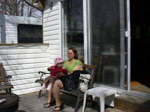 Free enclosed deck c/w patio 9' patio window and a 6' patio