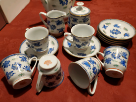 China tea set, teapot, teacups and saucers, milk jar, sugar pot