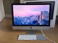 Apple iMac 27-inch with wireless keyboard and trackpad in original box.