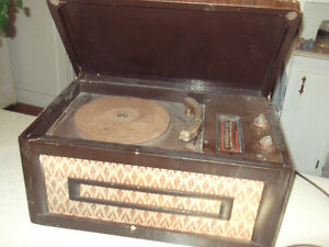 Old 78 rpm record player. Motor works but needs cleaning.