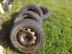 Four winter tires and rims vw jetta 2003