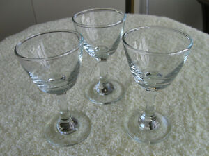 THREE PIECES of TINY CLEAR GLASS MATCHING STEMWARE....