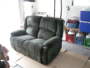 green fabric recliner loveseat