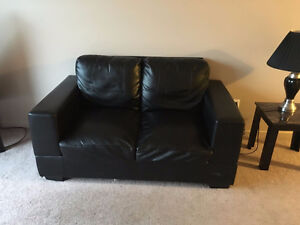 Black leather loveseat and sofa.