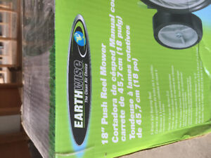 "New 18"" Earthwise Green no gas lawnmower for sale ! $100."