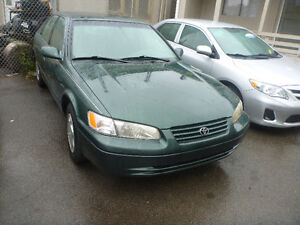 HERE WE HAVE A1999 TOYOTA CAMRY, A/C, POWER GROUP, VERY CLEA