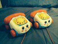 Two Fisher Price Dial Phones