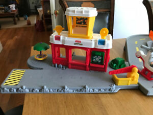 Fisher Price Airport with vehicles and people
